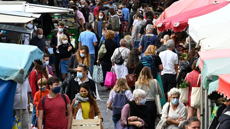 """People wearing a protective mask to curb the spread of the novel coronavirus (Covid-19) shop at a market on September 12, 2020 in Rennes, western France. - The evolution of the epidemiological situation of the coronavirus in France shows """"an obvious deterioration"""", the French Prime Minister declared on September 11. (Photo by Damien MEYER / AFP) (Photo by DAMIEN MEYER/AFP via Getty Images)"""