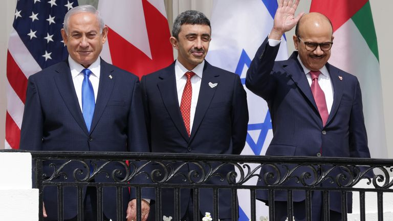 The three leaders ahead of the signing at the White House