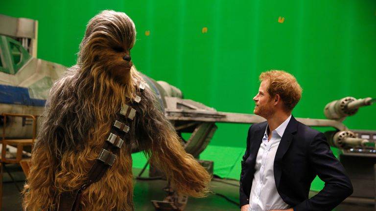 Britain's Prince Harry (R) meets Chewbacca during a visit to the Star Wars film set at Pinewood Studios near Iver Heath, west of London April 19, 2016