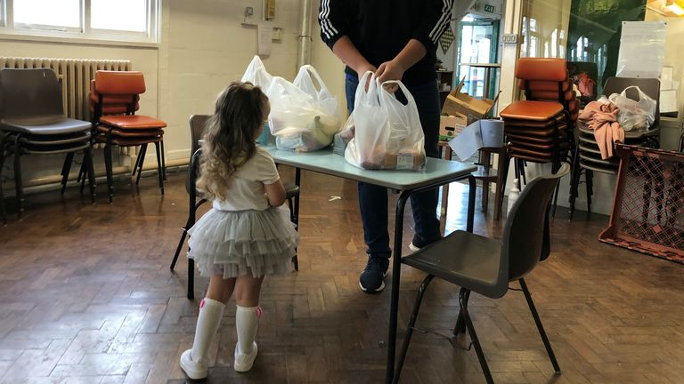 Two-year-old Rose collects food in Coventry