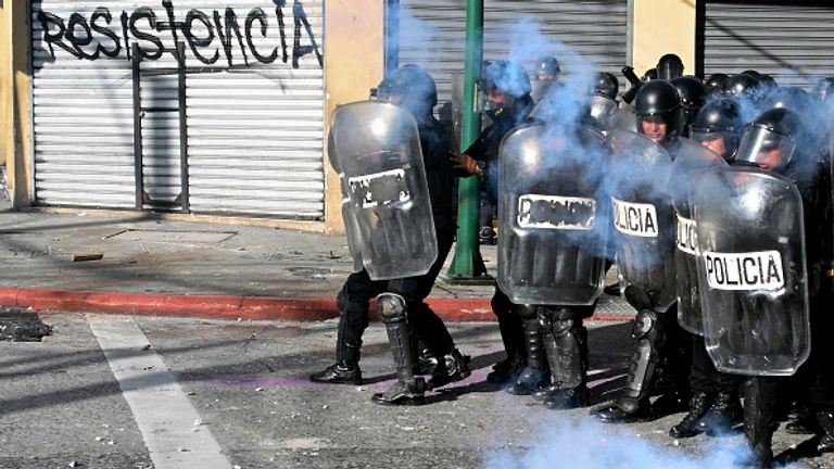 Riot police fired tear gas as they clashed with demonstrators